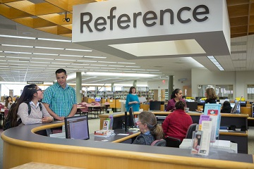Students getting help at the reference desk